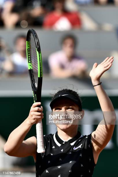 Romania's Simona Halep celebrates after winning against Poland's Iga Swiatek during their women's singles fourth round match on day nine of The...