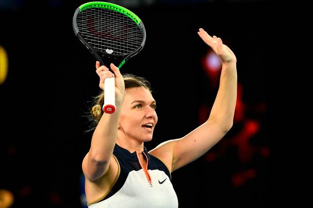 Romania's Simona Halep celebrates after winning against Russia's Veronika Kudermetova during their women's singles match on day five of the...