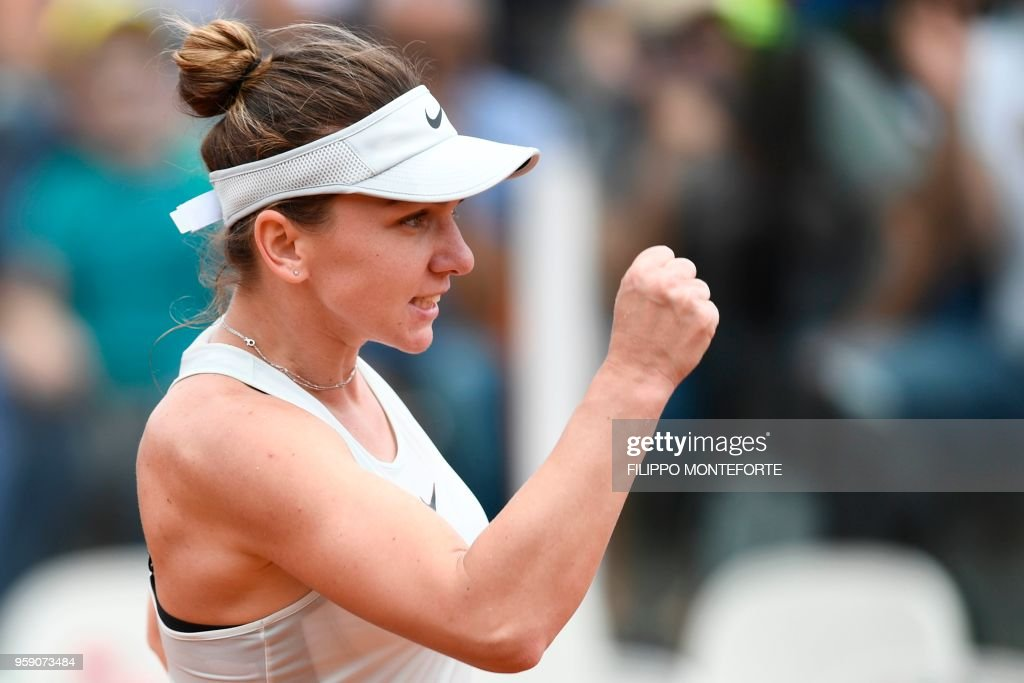 Romania's Simona Halep celebrates after winning her match against Japan's Naomi Osaka at Rome's WTA Tennis Open tournament at the Foro Italico, on May 16, 2018 in Rome.
