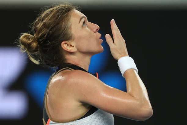 Romania's Simona Halep celebrates beating Australia's Ajla Tomljanovic during their women's singles match on day three of the Australian Open tennis...