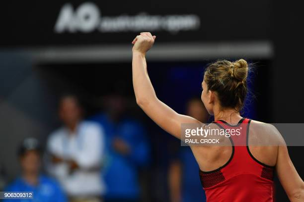 Romania's Simona Halep celebrates beating Canada's Eugenie Bouchard in their women's singles second round match on day four of the Australian Open...