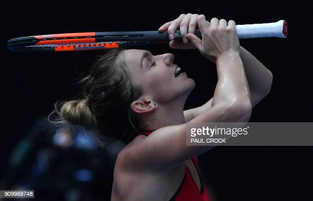 TOPSHOT Romania's Simona Halep celebrates beating Germany's Angelique Kerber in their women's singles semifinals match on day 11 of the Australian...