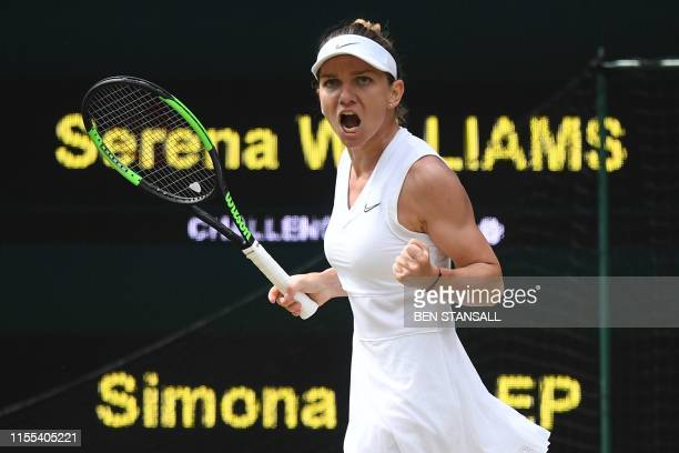 Romania's Simona Halep celebrates breaking the serve of US player Serena Williams in the second set during their women's singles final on day twelve...