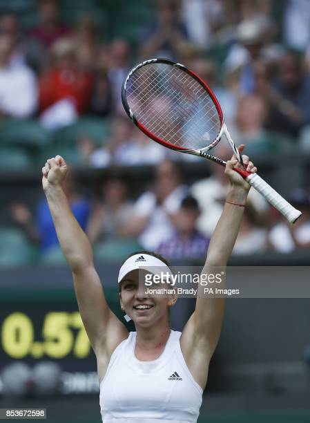 Romania's Simona Halep celebrates defeating Germany's Sabine Lisicki during day ten of the Wimbledon Championships at the All England Lawn Tennis and...