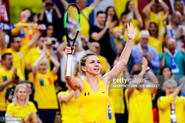 TOPSHOT Romania's Simona Halep celebrates winning against France's Kristina Mladenovic in the first rubber of the Fed Cup tennis semifinal match...