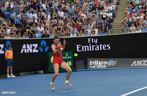 Romania's Simona Halep hits a return against Canada's Eugenie Bouchard during their women's singles second round match on day four of the Australian...