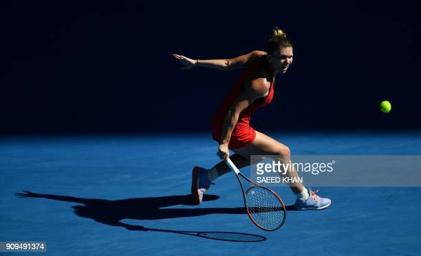 Romania's Simona Halep hits a return against Czech Republic's Karolina Pliskova during their women's singles quarterfinals match on day 10 of the...