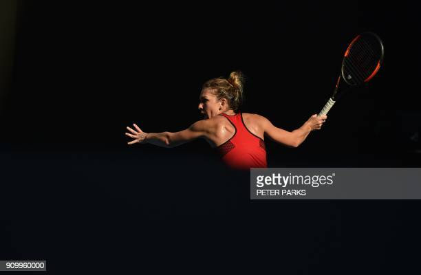 TOPSHOT Romania's Simona Halep hits a return against Germany's Angelique Kerber during their women's singles semifinals match on day 11 of the...