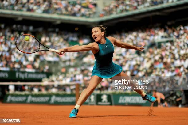 TOPSHOT Romania's Simona Halep plays a backhand return to Sloane Stephens of the US during their women's singles final match on day fourteen of The...