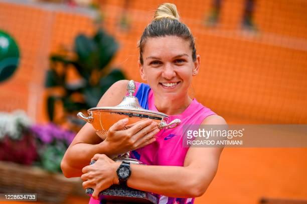 Romania's Simona Halep poses with her trophy after winning the final match of the Women's Italian Open against Czech Republic's Karolina Pliskova,...