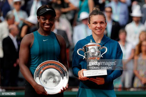 Romania's Simona Halep poses with the trophy with second placed Sloane Stephens of the US after winning the women's singles final match on day...