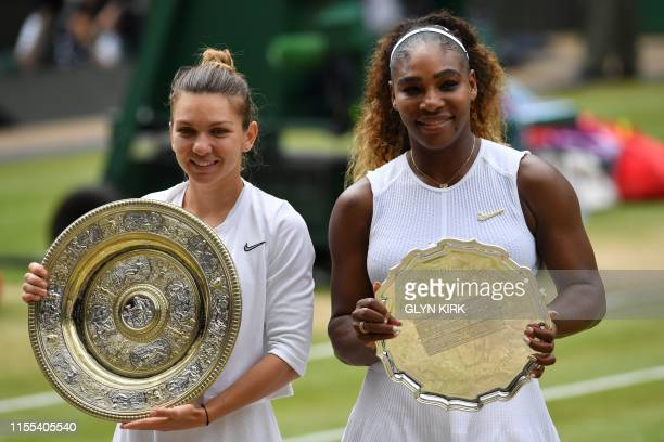 Romania's Simona Halep poses with the Venus Rosewater Dish trophy and US player Serena Williams poses with the runners up trophy after Halep won...