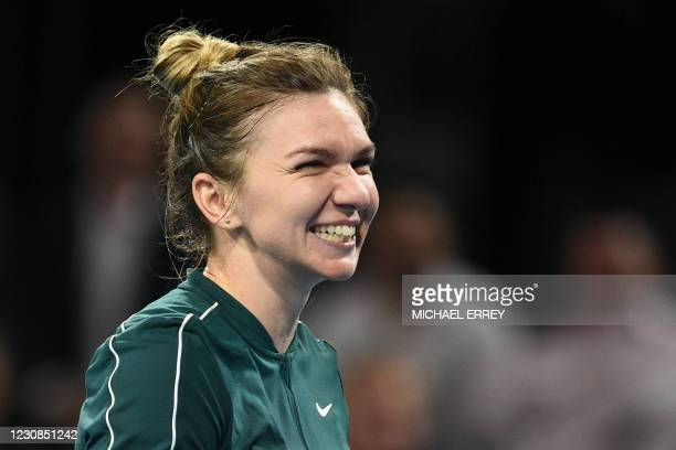 Romania's Simona Halep reacts after her women's singles match against Australia's Ashleigh Barty at the 'A Day at the Drive' exhibition tennis...