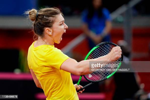 Romania's Simona Halep reacts during the third rubber against Caroline Garcia of France in the Fed Cup tennis semifinal match between France and...