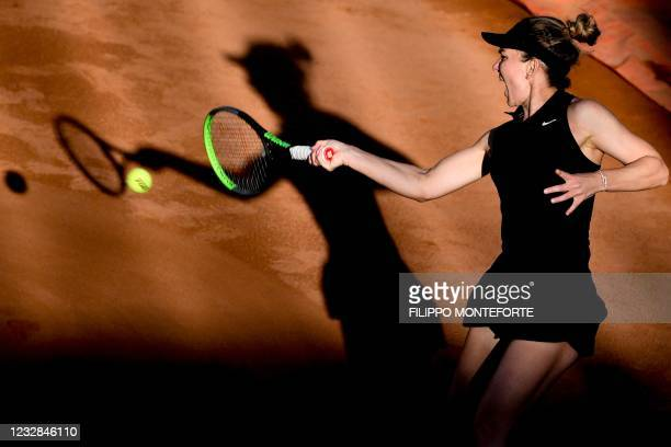 Romania's Simona Halep returns a shot to Germany's Angelique Kerber during their match of the Women's Italian Open at Foro Italico on May 12, 2021 in...