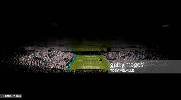 TOPSHOT Romania's Simona Halep returns against US player Serena Williams during their women's singles final on day twelve of the 2019 Wimbledon...