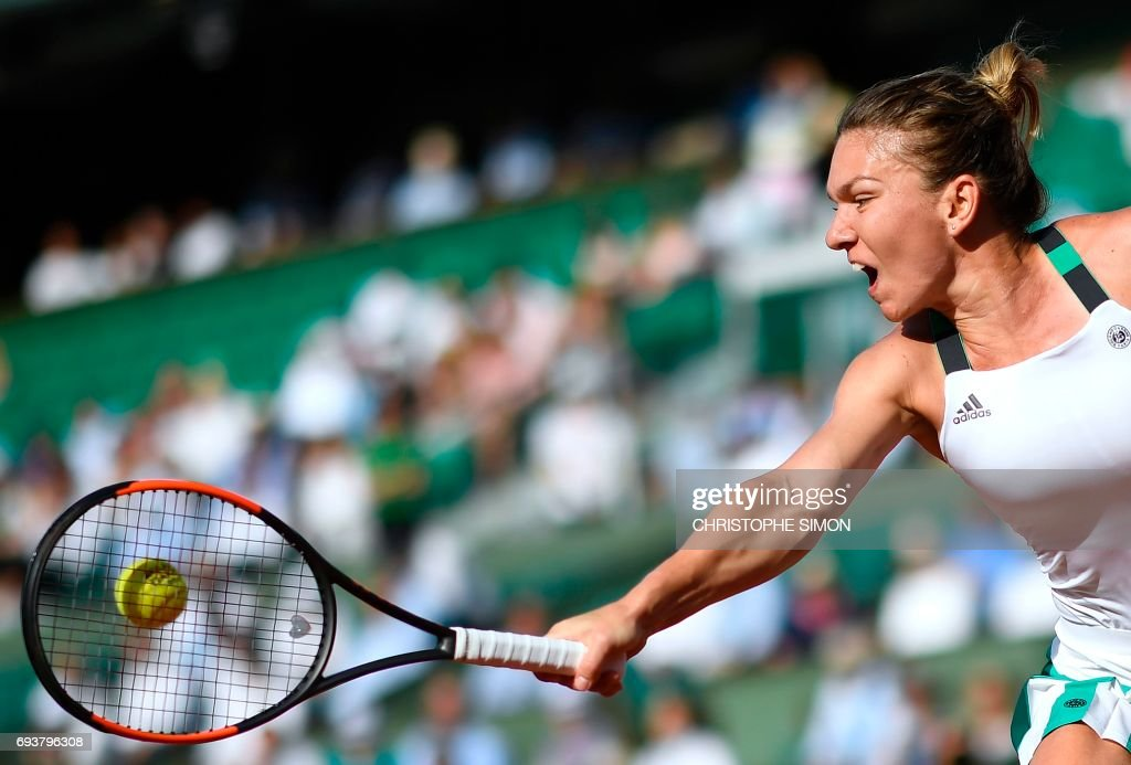 TOPSHOT - Romania's Simona Halep returns the ball to Czech Republic's Karolina Pliskova during their semifinal tennis match at the Roland Garros 2017 French Open on June 8, 2017 in Paris. /