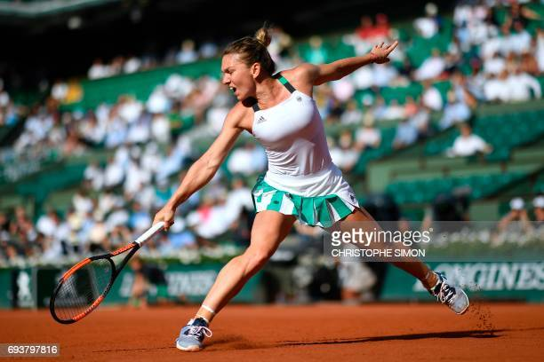 TOPSHOT Romania's Simona Halep returns the ball to Czech Republic's Karolina Pliskova during their semifinal tennis match at the Roland Garros 2017...