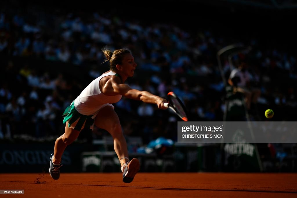 Romania's Simona Halep returns the ball to Czech Republic's Karolina Pliskova during their semifinal tennis match at the Roland Garros 2017 French Open on June 8, 2017 in Paris. /
