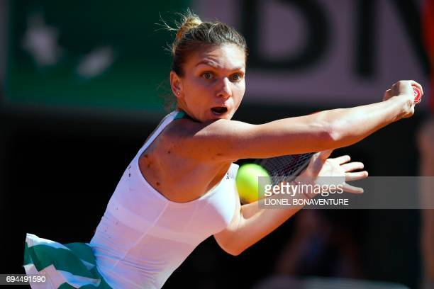 Romania's Simona Halep returns the ball to Latvia's Jelena Ostapenko during their final tennis match at the Roland Garros 2017 French Open on June...