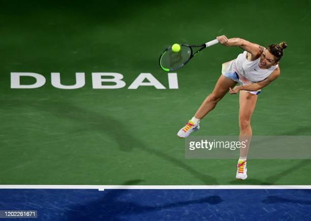 TOPSHOT Romania's Simona Halep returns the ball to US' Jennifer Brady during their Dubai Tennis Championships semifinal match in the Gulf emirate on...