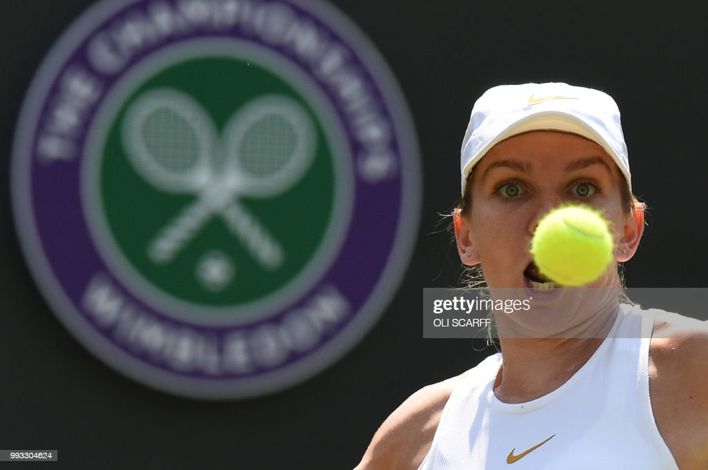 Romania's Simona Halep returns to Taiwan's Hsieh Su-Wei in their women's singles third round match on the sixth day of the 2018 Wimbledon Championships at The All England Lawn Tennis Club in Wimbledon, southwest London, on July 7, 2018. (Photo by Oli SCARFF / AFP) / RESTRICTED