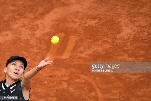 Romania's Simona Halep serves a ball to Poland's Iga Swiatek during their women's singles fourth round match on day nine of The Roland Garros 2019...