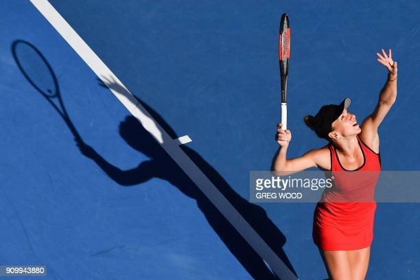 TOPSHOT Romania's Simona Halep serves against Germany's Angelique Kerber during their women's singles semifinals match on day 11 of the Australian...