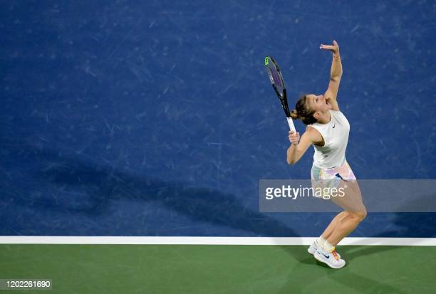 Romania's Simona Halep serves the ball to US' Jennifer Brady during their Dubai Tennis Championships semi-final match in the Gulf emirate on February...