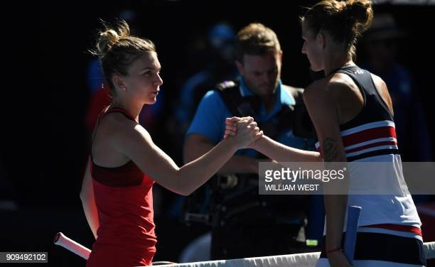 Romania's Simona Halep shakes hands with Czech Republic's Karolina Pliskova during their women's singles quarterfinals match on day 10 of the...