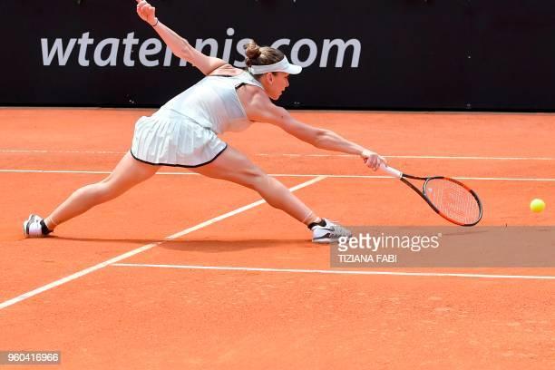 Romania's Simona Halep streches to return the ball during the women's final against Ukraine's Elina Svitolina at Rome's WTA Tennis Open tournament at...