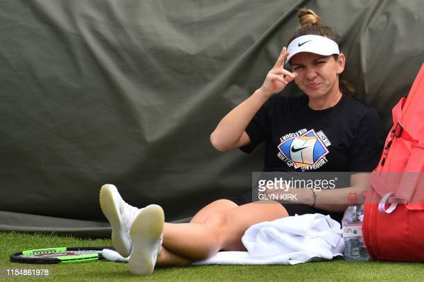 Romania's Simona Halep takes rest as she takes part in a session on the practice courts on day nine of the 2019 Wimbledon Championships at The All...