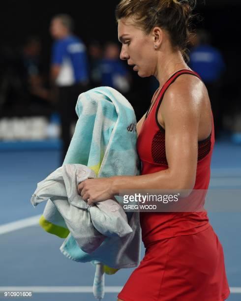 Romania's Simona Halep walks off the court as the heat rule comes into effect against Denmark's Caroline Wozniacki during their women's singles final...