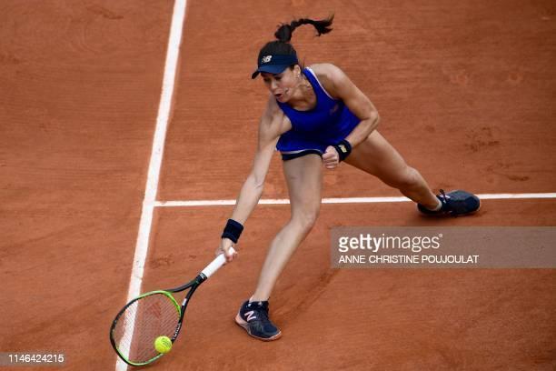 Romania's Sorana Cirstea returns the ball to Slovenia's Kaja Juvan during their women's singles first round match on day two of The Roland Garros...