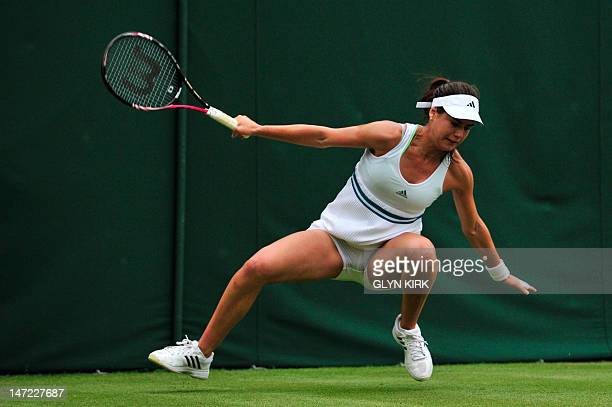 Romania's Sorana Cirstea slips on the court during her victory in her second round women's singles match against China's Li Na on day three of the...