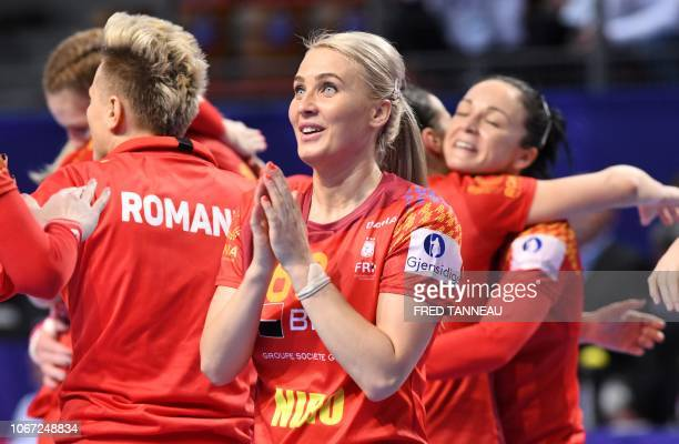 Romania's team players celebrate after winning at the end of the Women Euro 2018 handball Championships group D preliminary round match between...