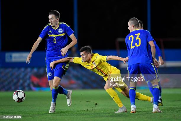 Romania's U21 Ianis Hagi in action against Bosnia and Herzegovina's Stjepan Radeljic and Marijan Cavar during European Under21 Championship 2019...