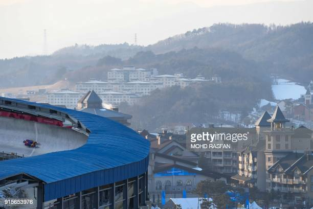 Romania's Valentin Cretu takes a corner during a training session for the men's luge singles during the Pyeongchang 2018 Winter Olympic Games at the...