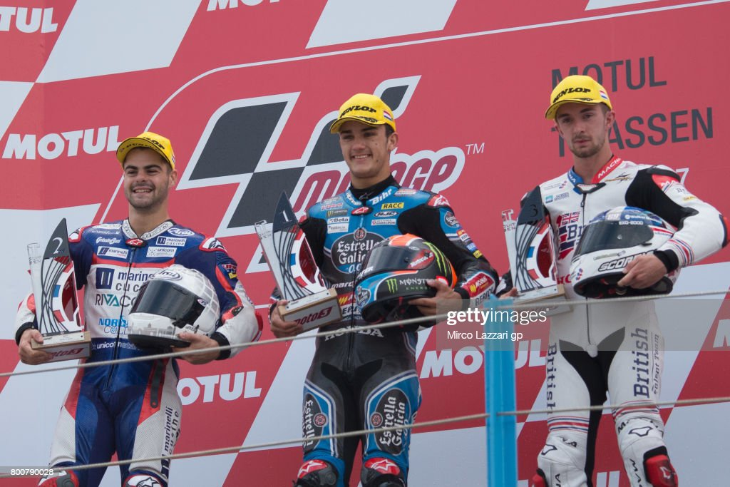 Romano Fenati of Italy and Marinelli Rivacold Snipers Team, Aron Canet of Spain and Estrella Galicia 0,0 and John McPhee of Great Britain and British Talent Team celebrate on the podium at the end of the Moto3 Race during the MotoGP Netherlands - RaceMotoGP Netherlands - Race on June 25, 2017 in Assen, Netherlands.