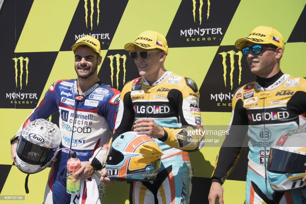 Romano Fenati of Italy and Marinelli Rivacold Snipers Team, Juanfran Guevara of Spain and RBA BOE Racing Team and Gabriel Rodrigo of Argentina and RBA BOE Racing Team celebrate at the end of the qualifying practice during the MotoGp of Czech Republic - Qualifying at Brno Circuit on August 5, 2017 in Brno, Czech Republic.