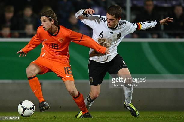 Romano van der Stoep of Netherlands and Matthias Ginter of Germany fight for the ball during the U18 international friendly match between Germany and...