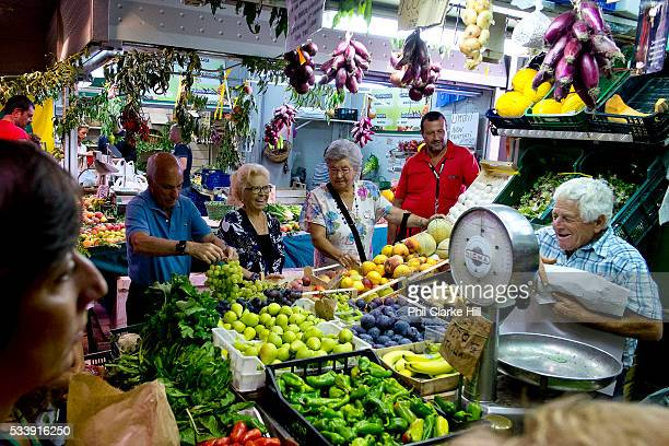 Romans buying their food at a local market Rome Italy