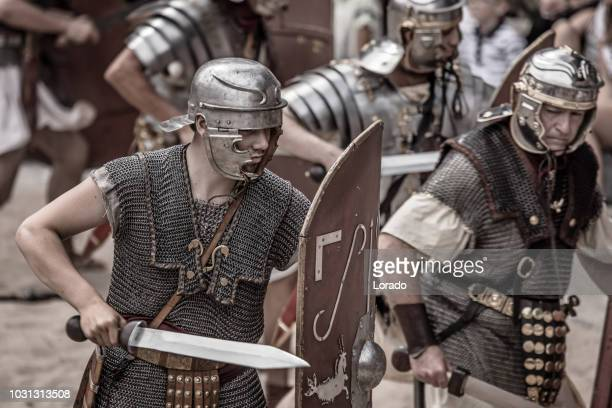 romans during a public performance - historical reenactment stock photos and pictures