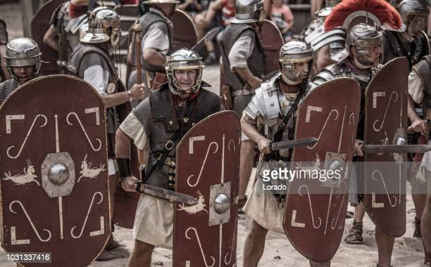 romans during a public performance - roman army stock pictures, royalty-free photos & images