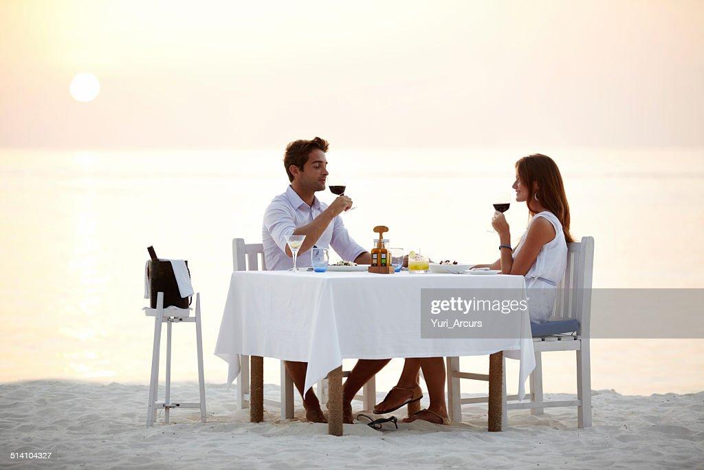 Romantic beach dinner : Stock Photo