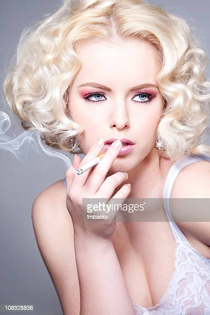romantic blond beauty - beautiful women smoking cigarettes stock photos and pictures