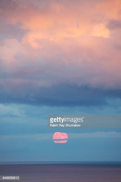 romantic blue moon rising on sunset - pink moon stock pictures, royalty-free photos & images