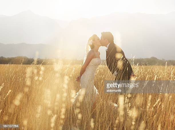 Romantic bride and groom kissing