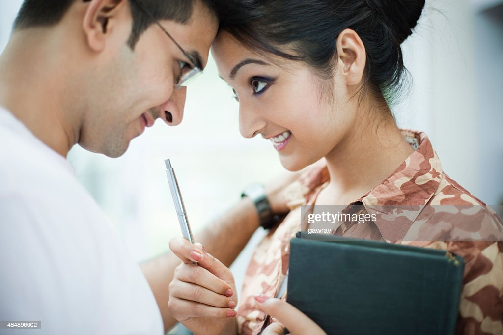 Romantic business woman and man touching forehead with each other. : Stock Photo