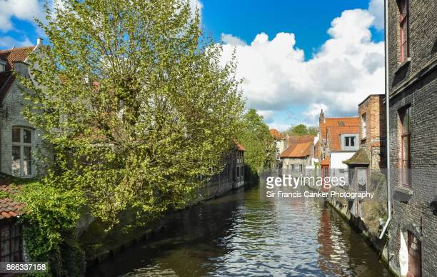 Romantic canal in Bruges with ancient medieval houses in Flanders, Belgium a UNESCO heritage site